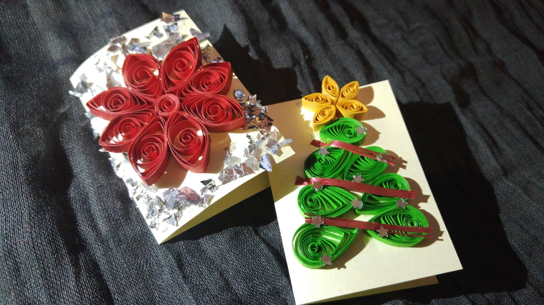 Two handmade Christmas gift tags - a red flower and a Christmas tree with a star