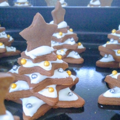 A few complete Gingerbread Christmas trees decorated with icing and sprinkles