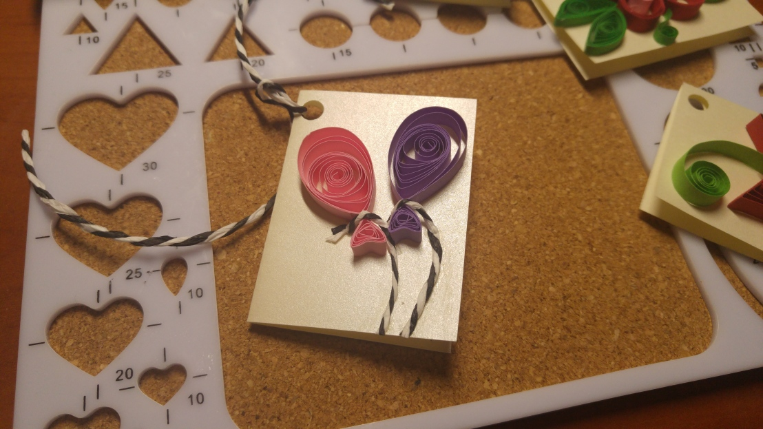 A handmade gift tag - balloons - quilling