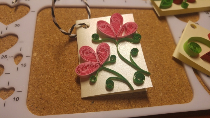 A handmade quilled gift tag - two pink roses