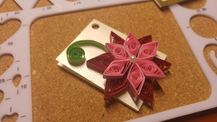 A handmade quilled gift tag -