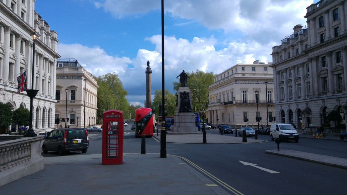 Central London - red bus, telephone booth and British flag