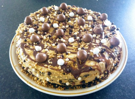 Coffee and Nutella cake, decorated, on a plate