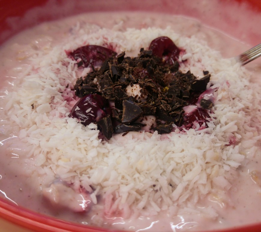 Cherry and coconut porridge in a bowl
