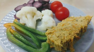 Red lentil vegetarian pate and vegetables on a plate