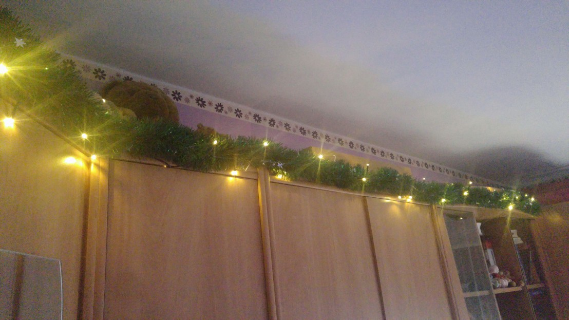 Finished garland on top of furniture with yellow lights