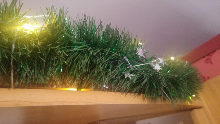Finished garland with silver stars and yellow lights