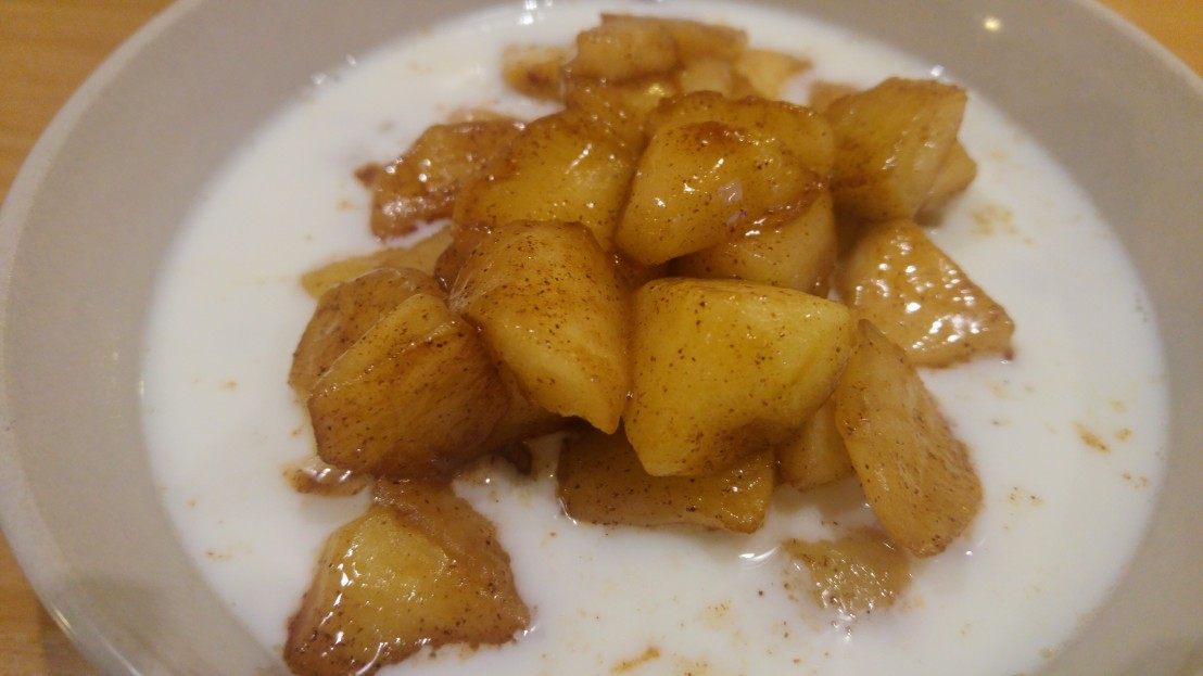 Caramelized apples in a bowl with porridge