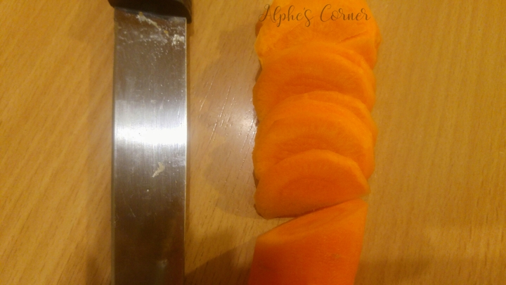 Sliced carrot next to a knife