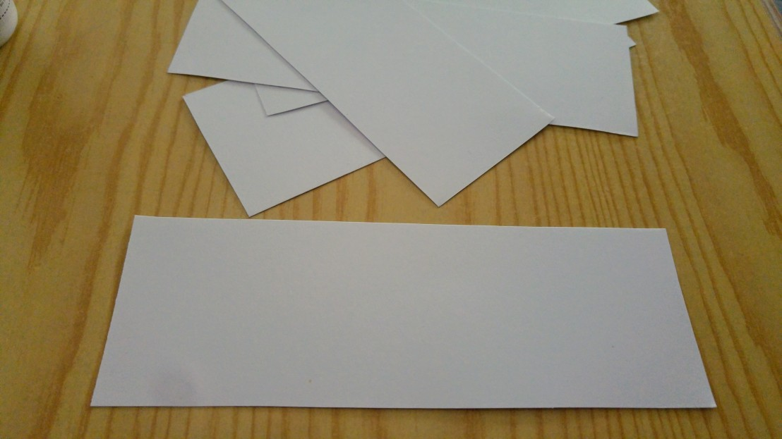Pieces of thick white paper cut to size