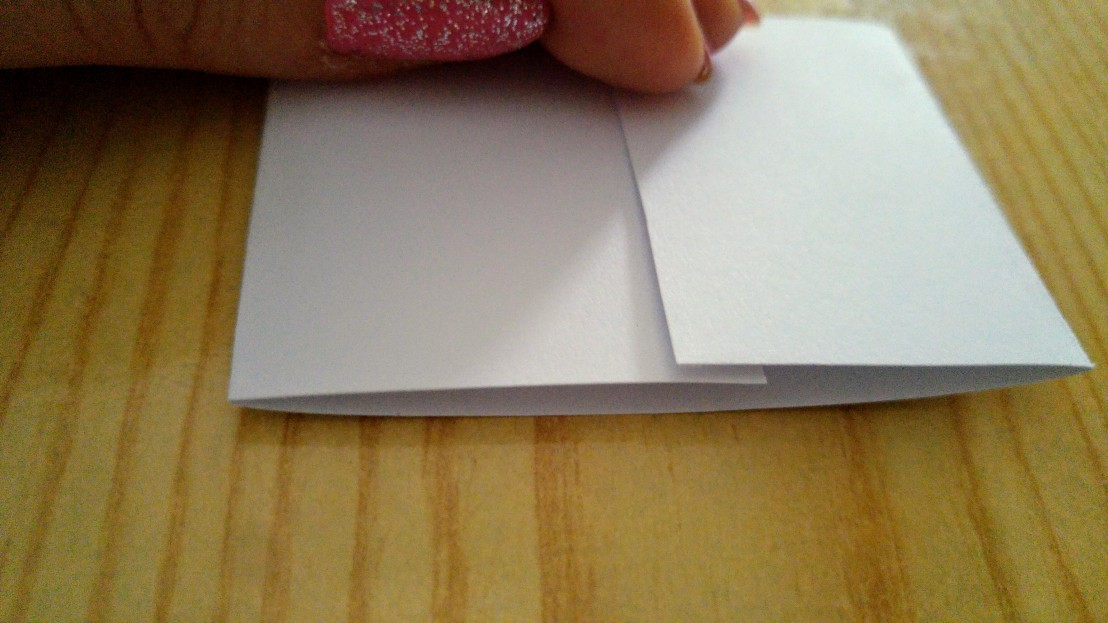 A piece of thick white paper folded to form a band