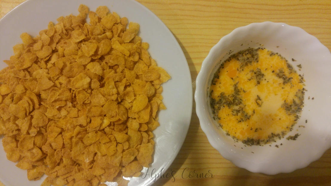 Corn Flakes on a plate and a bowl with egg and seasoning