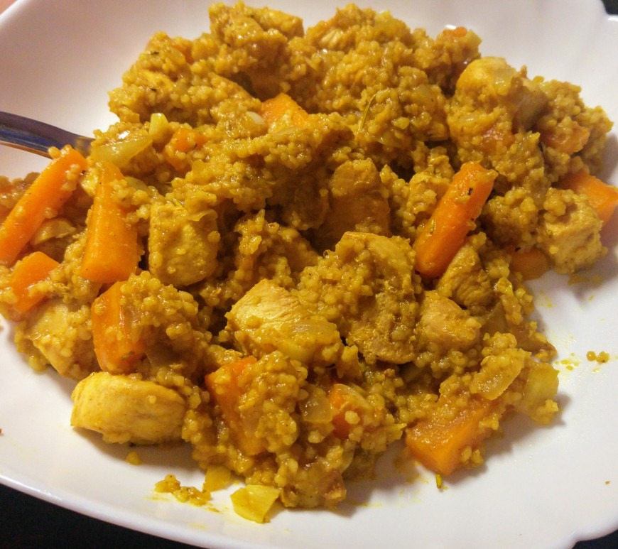 Couscous, chicken and carrot stir-fry on a plate