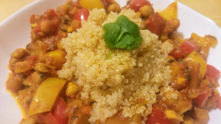 Chickpea, tomato and bell pepper curry served with quinoa, garnished with rice