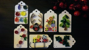7 handmade Christmas gift tags made with swirled paper strips