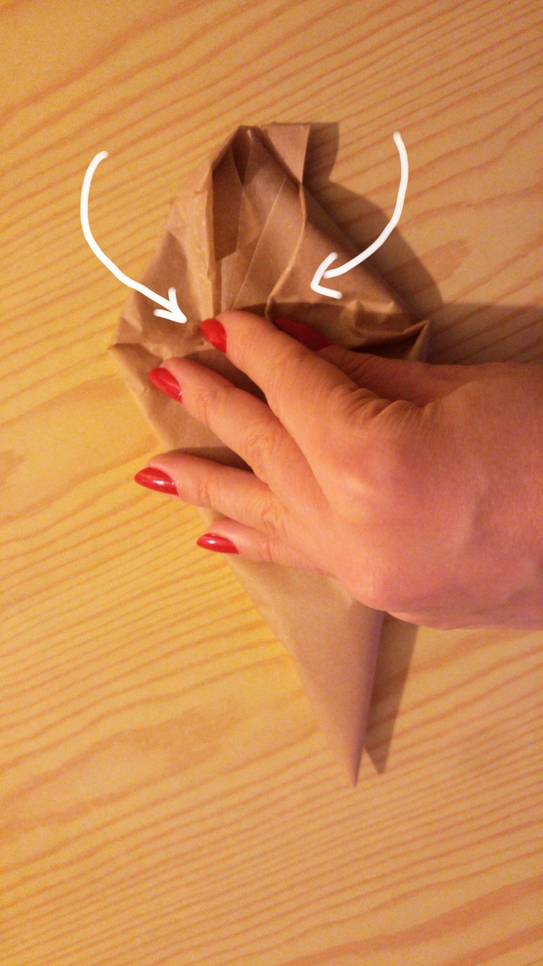 Closing the filled DIY piping bag