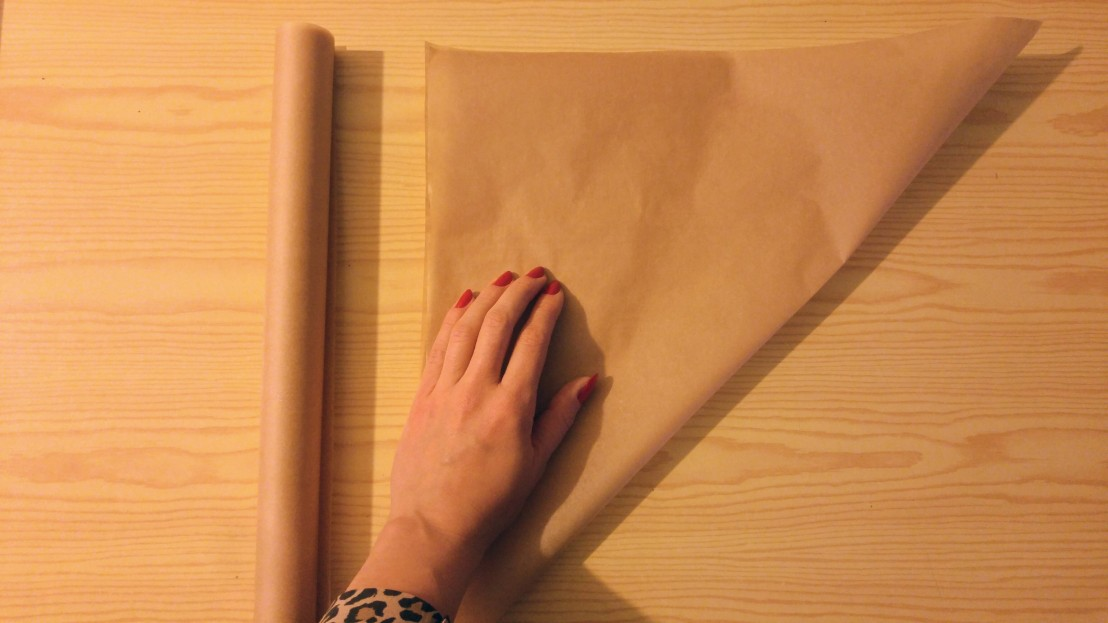 Cutting the piece of baking paper required to make piping cones