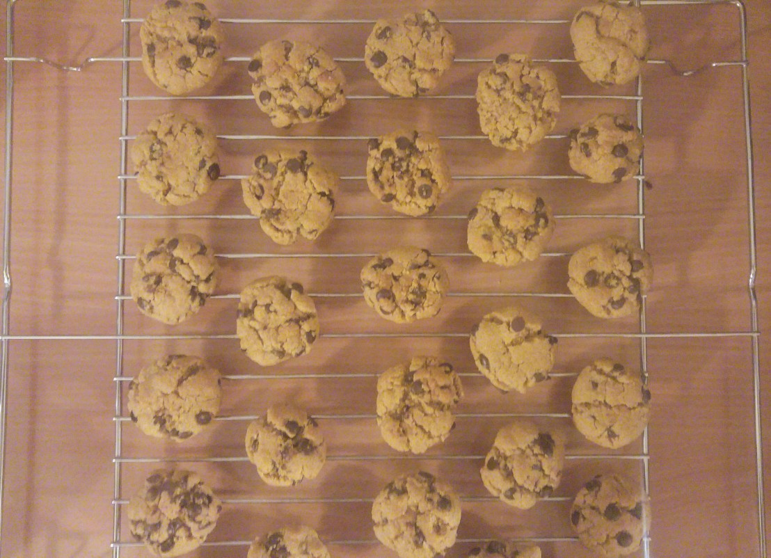 Baked flourless chocolate chip peanut butter cookies on a cooling rack