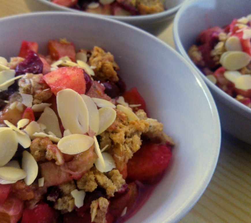 Fruit crumble served in bowls, garnished with almond flakes