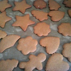 Baked gingerbread cut out cookies on a baking tray