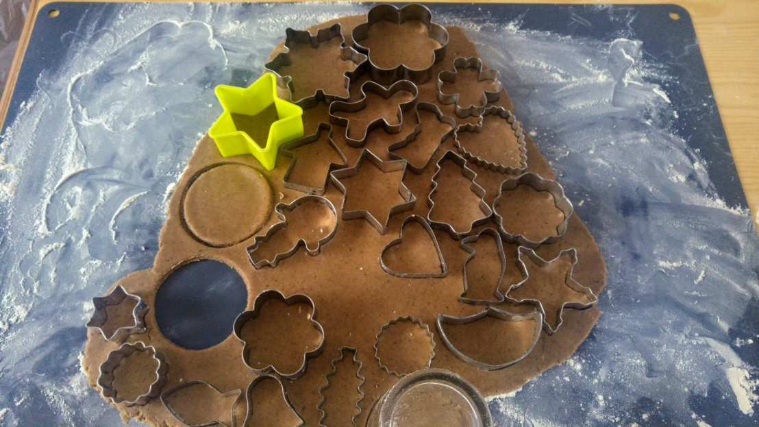 Gingerbread cookies being cut out