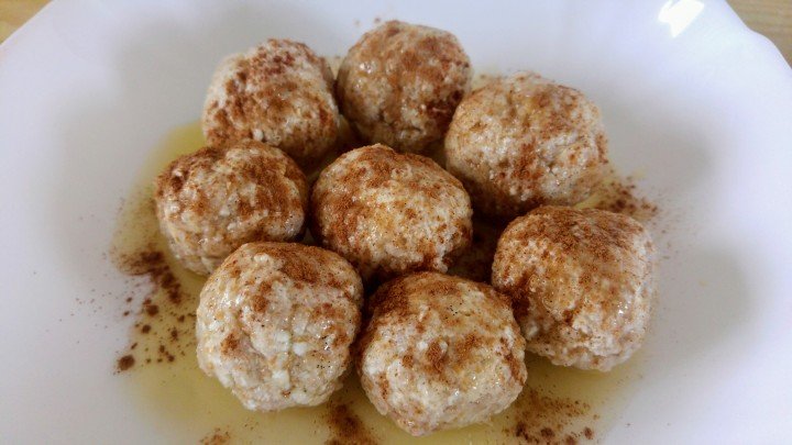 Kopytka - quark cheese dumplings - with butter and cinnamon, on a plate