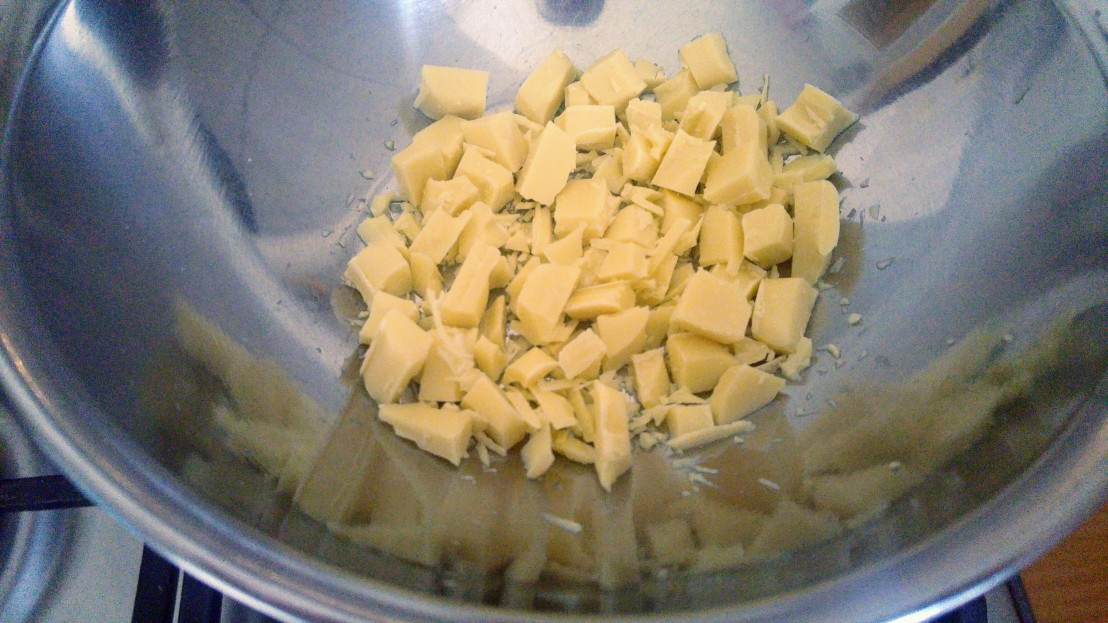 Chopped up white chocolate in a metal bowl