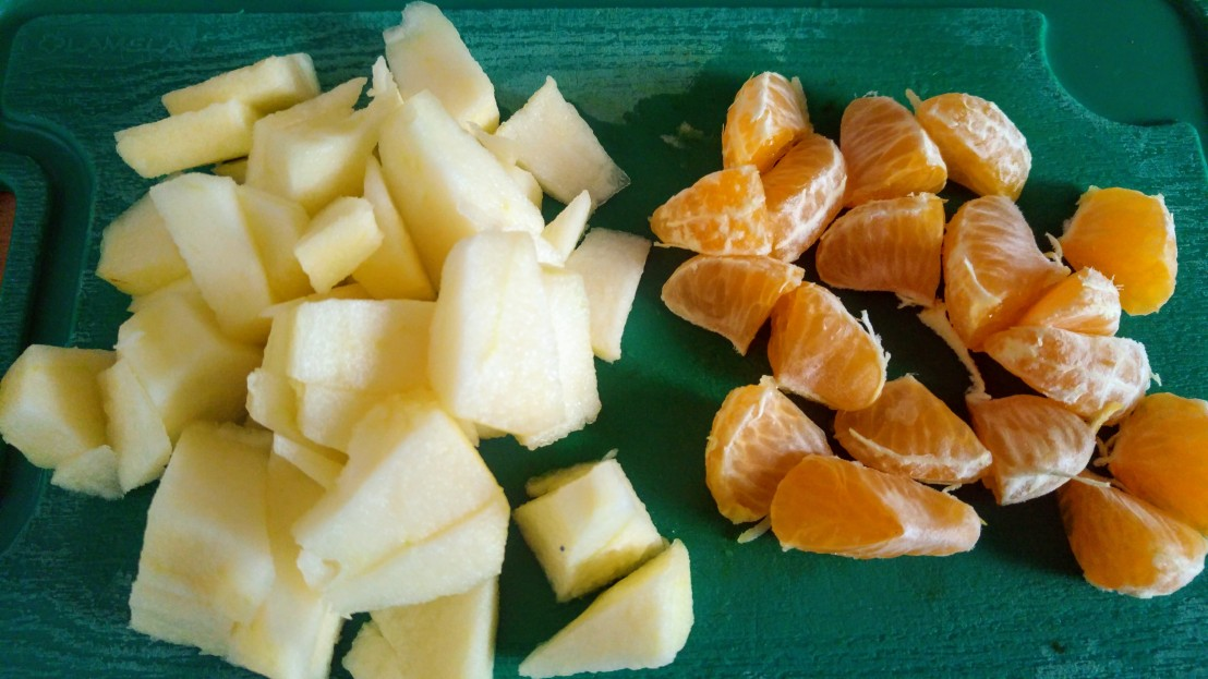 Chopped up apple and tangerine