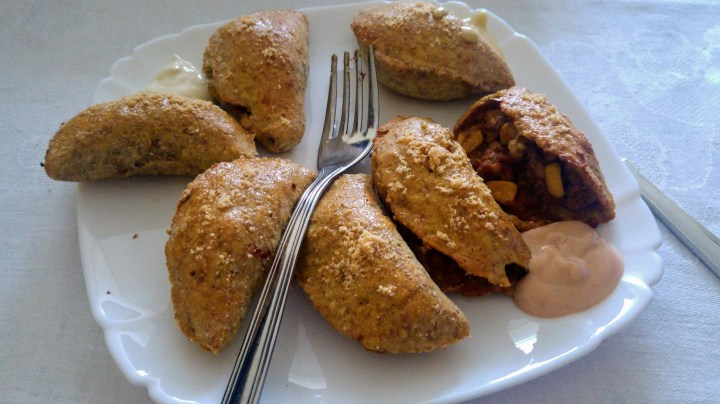 Oven baked dumplings with dips, on a plate