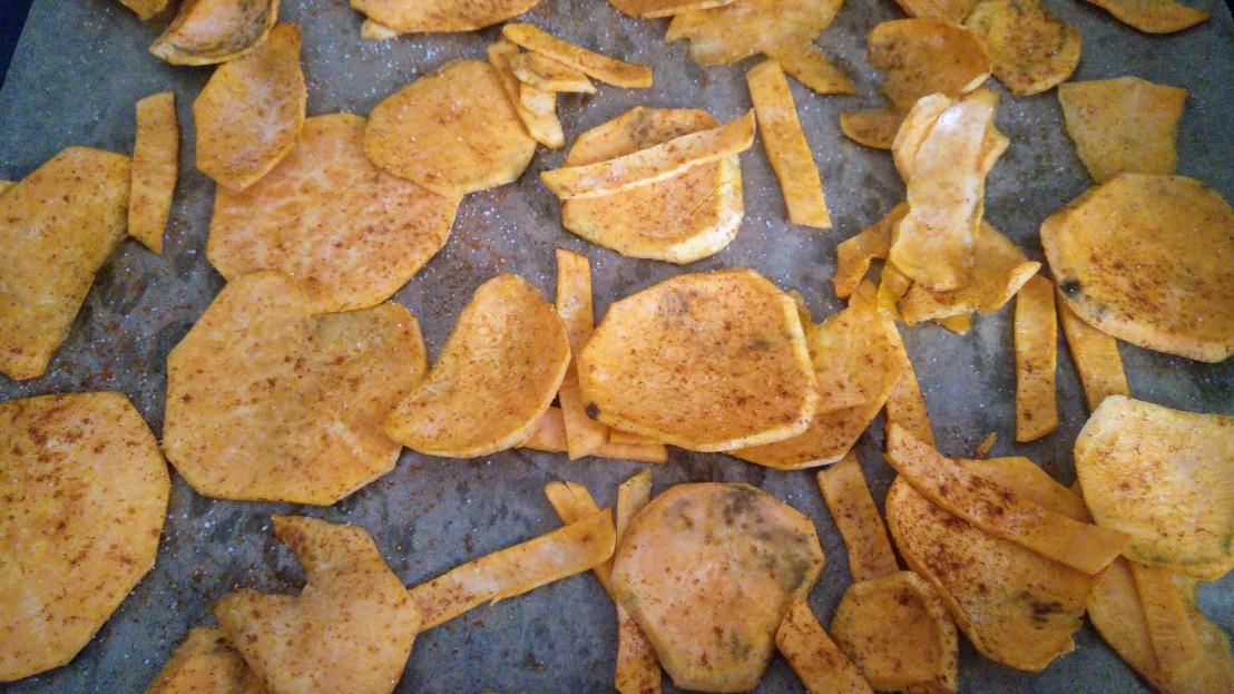 Slices of raw sweet potato on a baking tray