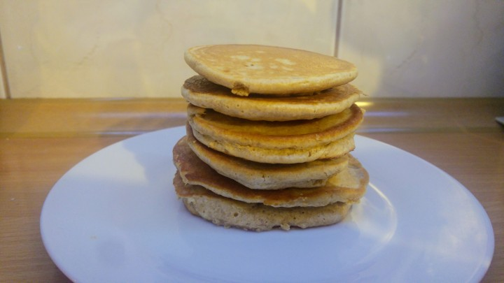 A pile of peanut butter pancakes on a plate