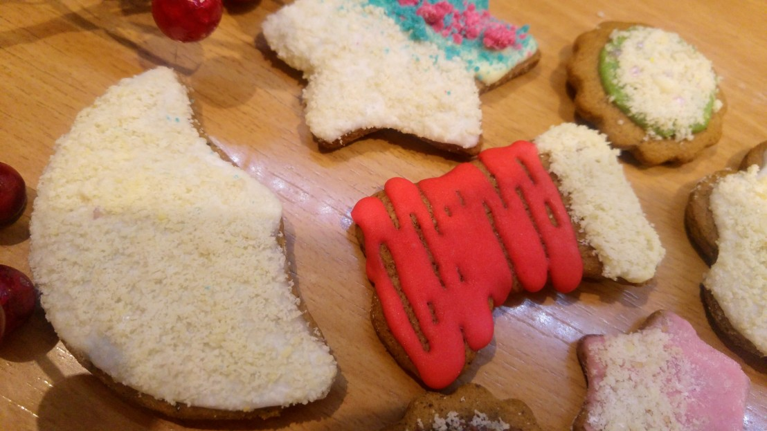 Cookies decorated with coloured royal icing and ground almonds