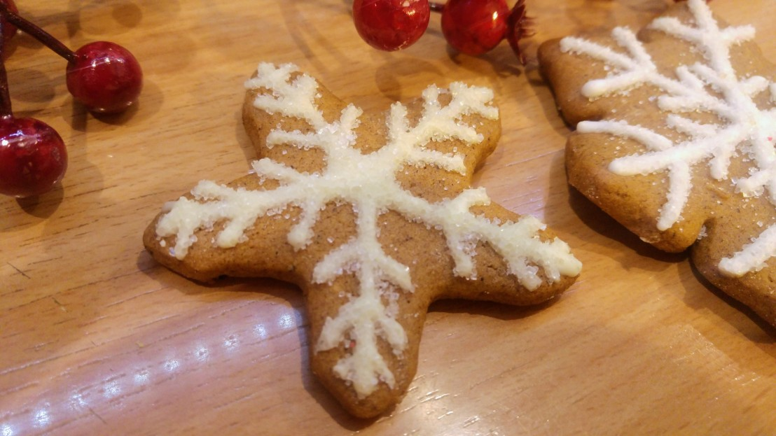 Cookies decorated with white royal icing and sugar