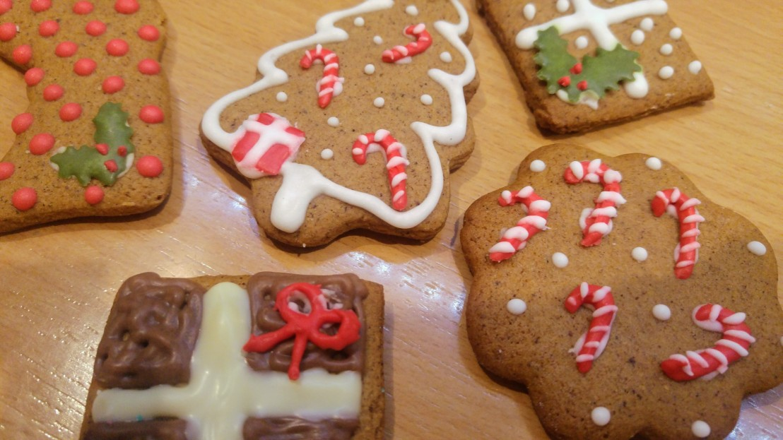 Gingerbread cookies decorated with icing - candy cane and Christmas tree