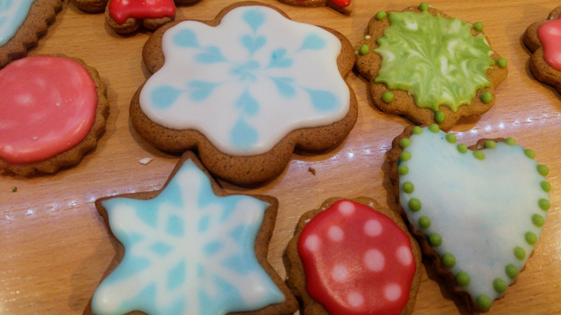 Gingerbread cookies decorated with wet in wet royal icing