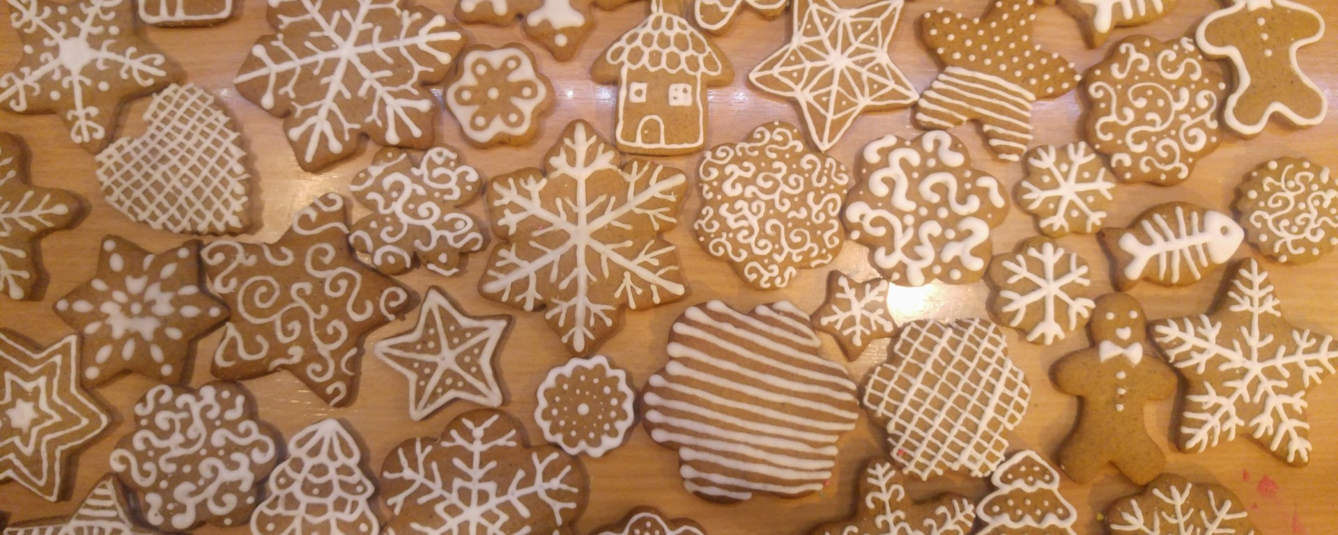 Gingerbread cookies decorated with white royal icing