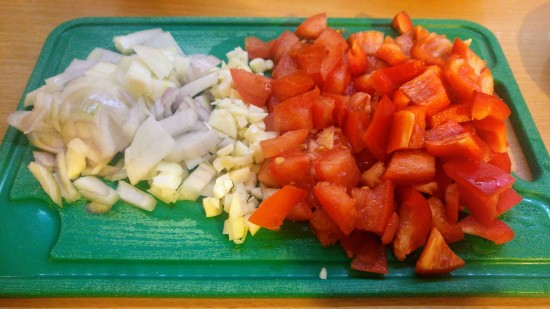 Chopped up bell peppers and onions for shakshuka