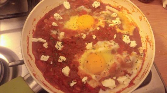 Shakshuka in progress, on a frying pan