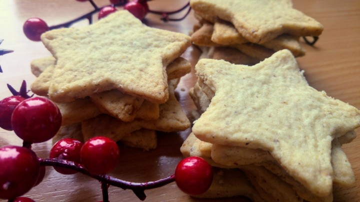 A few piles of star shaped Christmas walnut cookies