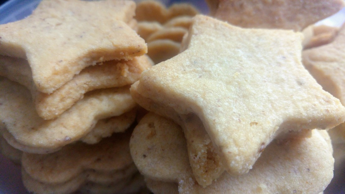 Piles of star shaped Christmas walnut cookies