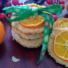 A batch of cookies with slices of tangerine