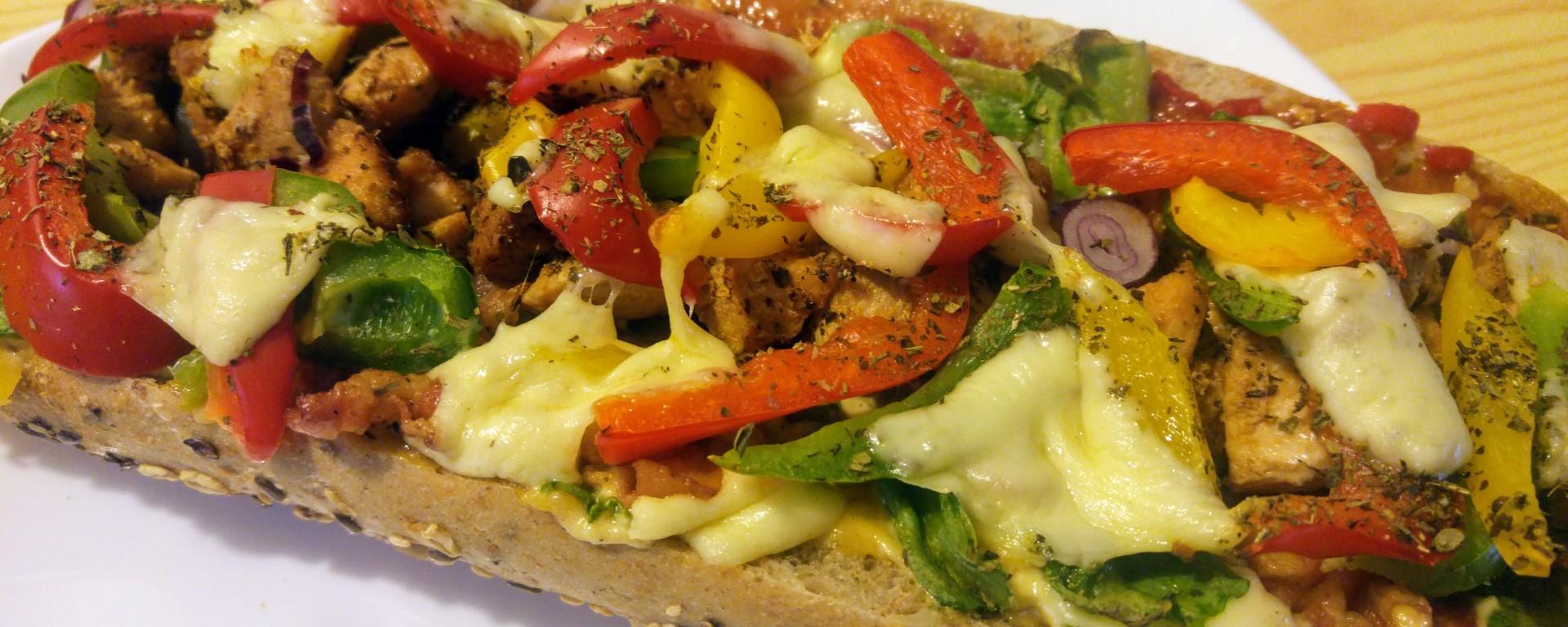 Zapiekanki - oven baked baguette on a plate