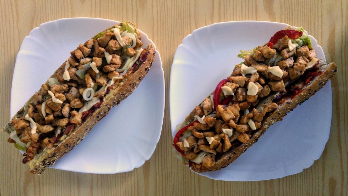 Zapiekanki - two baguettes on plates before baking