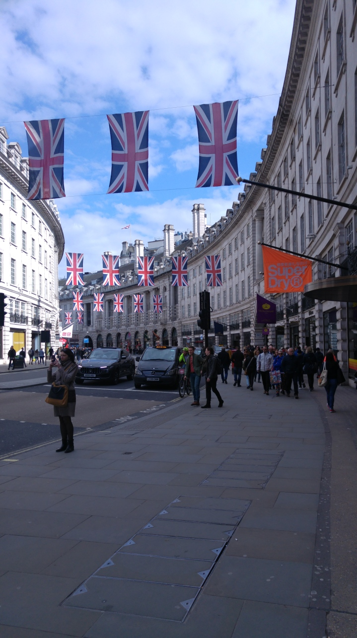 London trip - a street with many British flags