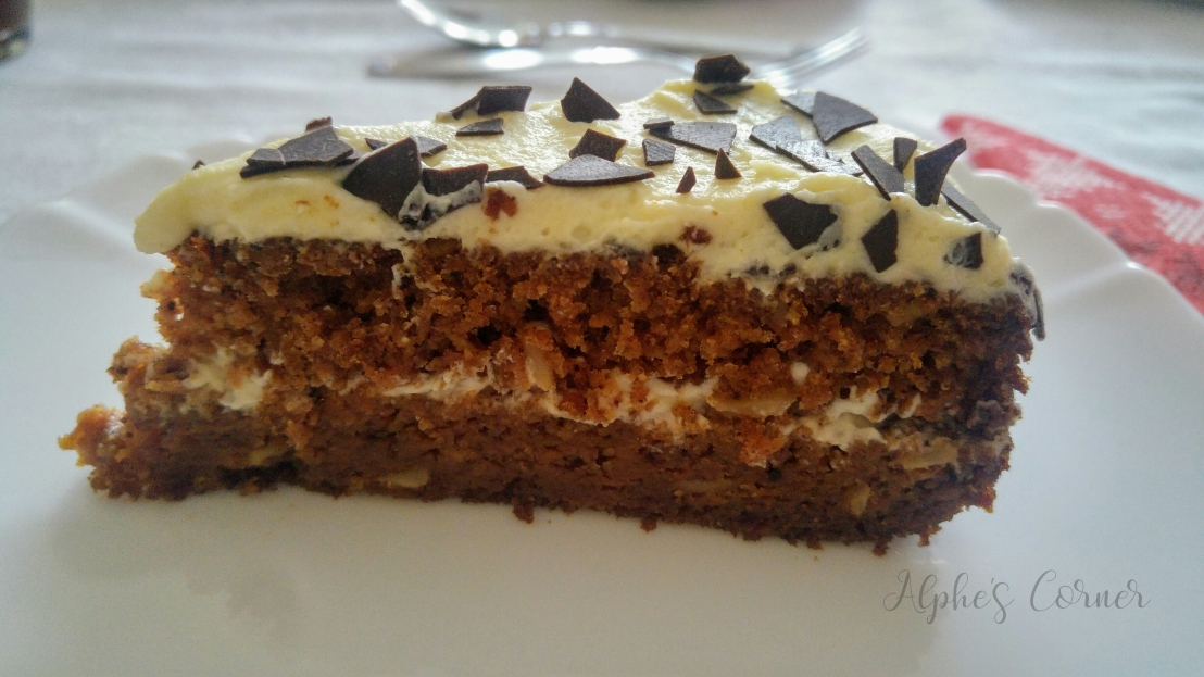 A slice of white chocolate carrot cake on a plate