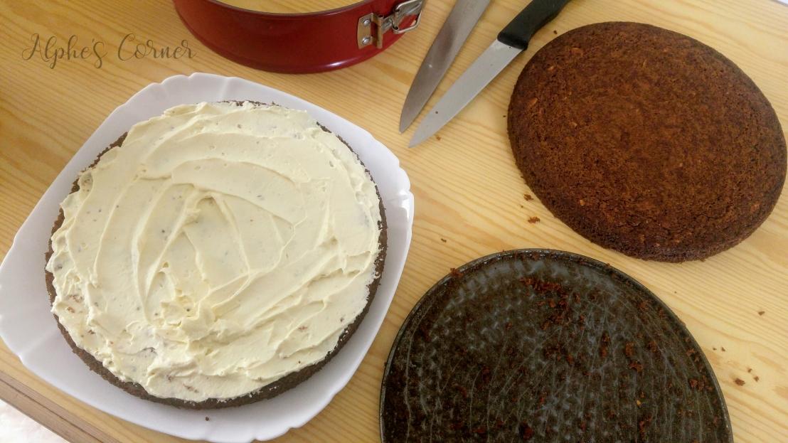 Sliced round carrot cake, white chocolate cream spread on the bottom