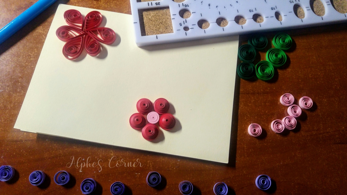 Quilling flowers, purple petals and the base card