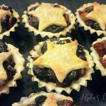 Baked mince pies on a baking tray