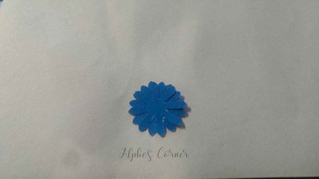 Mini paper flowers - three flowers glued together