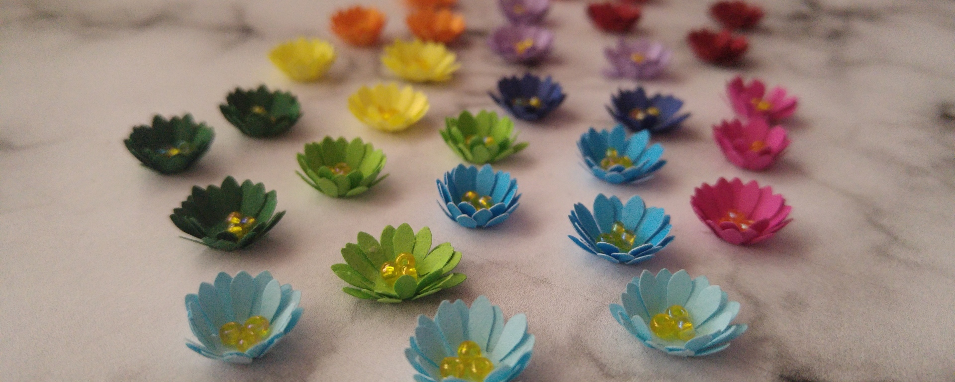 Multiple colourful mini paper flowers